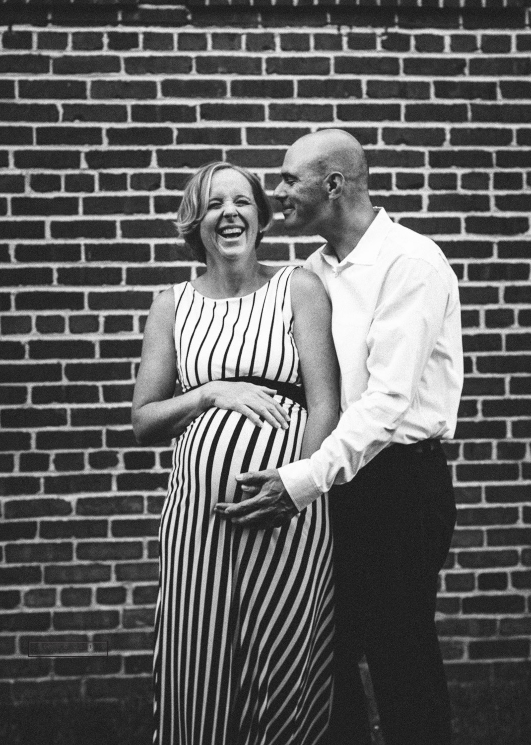 Pregnant mom laughing with husband