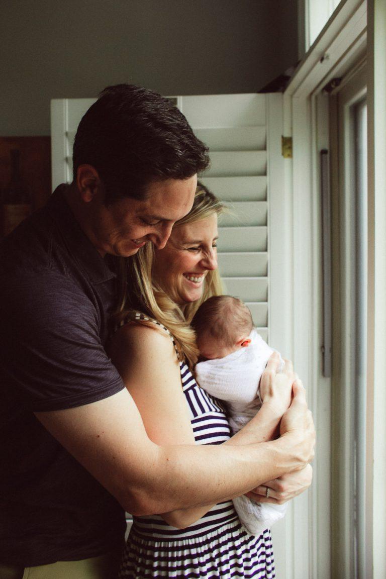 family holding newborn baby